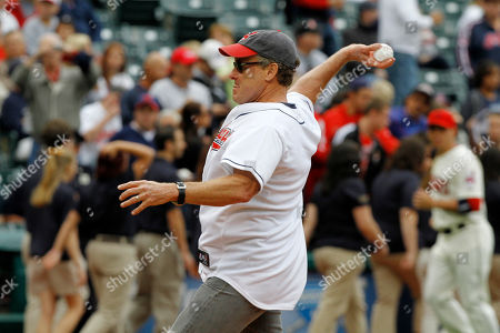 John McGinley Actor John McGinley throws a first pitch before a baseball game between the Cleveland Indians and the Detroit Tigers, in Cleveland
