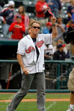 John McGinley Actor John McGinley waves before throwing a first pitch before a baseball game between the Cleveland Indians and the Detroit Tigers, in Cleveland