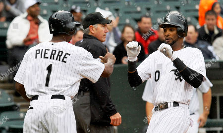 Juan Pierre, Alexei Ramirez Chicago White Sox's Juan Pierre, left, greets Alexei Ramirez at home after the pair scored on Paul Konerko's two-run single off Detroit Tigers starting pitcher Brad Penny during the second inning of a baseball game, in Chicago