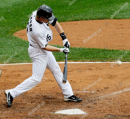 Gordon Beckham Chicago White Sox's Gordon Beckham hits an RBI double off Detroit Tigers starting pitcher Brad Penny, scoring Alejandro De Aza, during the sixth inning of a baseball game, in Chicago