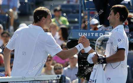 Novak Djokovic, Conor Niland Novak Djokovic of Serbia shakes hands with Conor Niland of Ireland after their match in the first round of the U.S. Open tennis tournament in New York