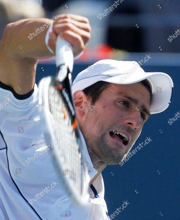 Novak Djokovic Novak Djokovic of Serbia serves to Conor Niland of Ireland during the first round of the U.S. Open tennis tournament in New York