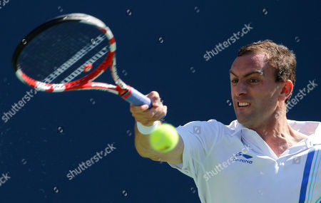 Conor Niland Conor Niland returns a shot to Novak Djokovic of Serbia during the first round of the U.S. Open tennis tournament in New York
