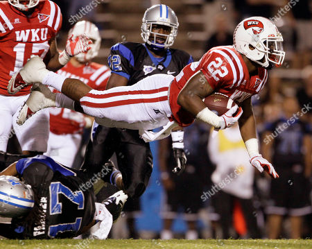 Tyree Robinson, Jamar Brown Western Kentucky's Tyree Robinson (22) is tripped up by Middle Tennessee's Reginald Farmer (17) as Robinson returns a kickoff in the fourth quarter of an NCAA college football game, in Murfreesboro, Tenn. Western Kentucky won 36-33 in double overtime