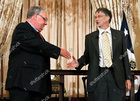 Howard Buffett, Bill Gates World Food Program's 2011 George McGovern Leadership Award recipient Bill Gates, right, and Howard Buffett, shake hands during a ceremony honoring him them at the State Department in Washington