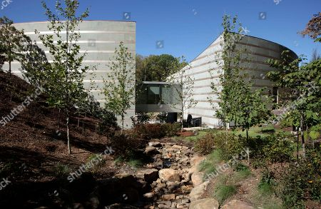 Taken, sections of Crystal Bridges Museum of American Art are constructed in a tree-lined ravine in Bentonville, Ark. The Moshe Safdie designed museum opened Nov. 11