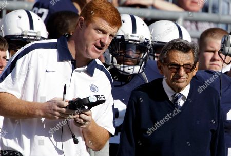 Mike McQueary, Joe Paterno Penn State assistant coach Mike McQueary, left, talks with head coach Joe Paterno during an NCAA college football game against Iowa in State College, Pa. In 2002, State Attorney General Linda Kelly said a graduate assistant, identified by two people familiar with the investigation as McQueary, saw former defensive coordinator Jerry Sandusky sexually assault a naked boy, estimated to be about 10 years old, in a team locker room shower. Paterno was fired on Nov. 10, 2011, in the aftermath of child sex-abuse charges against Sandusky, who maintains his innocence. Paterno is not a target of the investigation