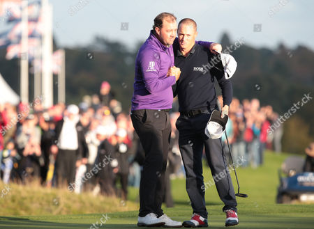 Alex Noren of Sweden celebrates on the 18th green with Peter Hanson (SWE) during The British Masters 2016 supported by SkySports  Round  4at The Grove Golf Course on October 16, 2016 in Watford, England.