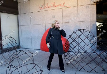 Widow of late Czech Republic's President Vaclav Havel, Dagmar Havlova poses for a photo by a memorial that was unveiled on the eve of 80th anniversary of his birth in Prague, Czech Republic