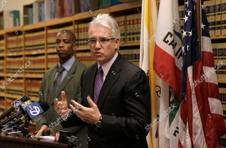 George Gascon San Francisco District Attorney George Gascon, right, speaks at a news conference with Paul Henderson of the San Francisco Mayor's office, in San Francisco. Nearly 18 years after a gunman stormed San Francisco's 101 California office tower and opened fire, killing eight people and himself, city officials are marking the anniversary with a call for tougher gun controls