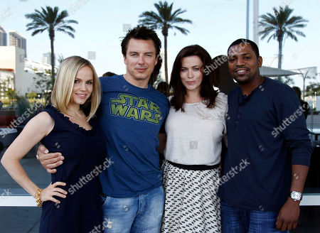 "Stock Image of Alexa Havins, John Barrowman, Eve Myles, Mekhi Phifer From left, cast members Alexa Havins, John Barrowman, Eve Myles, and Mekhi Phifer, from the Starz series ""Torchwood: Miracle Day"", pose for a portrait during Comic Con in San Diego"