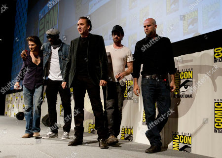 """Johnny Whitworth, Idris Elba, Nicolas Cage, Brian Taylor Mark Neveldine Cast and crew members from the movie """"Ghost Rider - Spirit of Vengeance,"""" walk off stage during the Sony panel at Comic Con, in San Diego. They are, from left, Johnny Whitworth, Idris Elba, Nicolas Cage, and directors Brian Taylor and Mark Neveldine"""