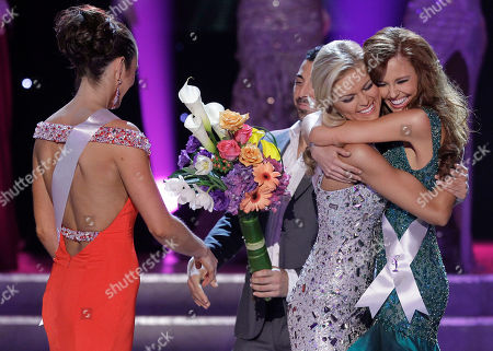 Stock Image of Madeline Mitchell, Alyssa Campanella, Ashley Elizabeth Durham Madeline Mitchell, left, Miss Alabama, walks away as Alyssa Campanella, Miss California, right, and Miss Tennessee, Ashley Elizabeth Durham react as they are annouced as the two remaining finalists in the 2011 Miss USA pageant, in Las Vegas