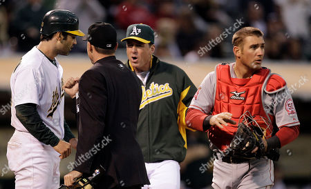 Conor Jackson, Jeff Mathis, Dan Iassogna, Bob Melvin From left, Oakland Athletics' Conor Jackson, argues a call with home plate umpire Dan Iassogna as A's manager Bob Melvin joins during the fourth inning of a baseball game against the Los Angeles Angels, in Oakland, Calif. At right is Angels catcher Jeff Mathis