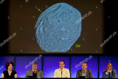 Colleen Hartman, Christopher Russell, Marc Rayman, Holger Sierks NASA/Jet Propulsion Laboratory scientists unveil the first full-frame image of the massive asteroid Vesta taken on July 24, 2011 by NASA's Dawn spacecraft, during a news conference at the Jet Propulsion Laboratory in Pasadena, Calif., on . Scientist from left: Colleen Hartman, assistant associate administrator, Science Mission Directorate, NASA Washington. Christopher Russell, Dawn principal investigator, UCLA. Marc Rayman, Dawn chief engineer and mission manager, JPL. Holger Sierks, framing camera team, Max Planck Society, Katlenburg-Lindau, Germany. Enrico Flamini, chief scientist, Italian Space Agency (ASI), Rome, Italy