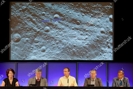 Colleen Hartman, Christopher Russell, Marc Rayman, Holger Sierks NASA/Jet Propulsion Laboratory scientists unveil a detail image of the massive asteroid Vesta taken on July 24, by NASA's Dawn spacecraft, seen superimposed top left for scale, during a news conference at JPL in Pasadena, Calif., on . Scientist from left: Colleen Hartman, assistant associate administrator, Science Mission Directorate, NASA Washington. Christopher Russell, Dawn principal investigator, UCLA. Marc Rayman, Dawn chief engineer and mission manager, JPL. Holger Sierks, framing camera team, Max Planck Society, Katlenburg-Lindau, Germany. Enrico Flamini, chief scientist, Italian Space Agency (ASI), Rome, Italy