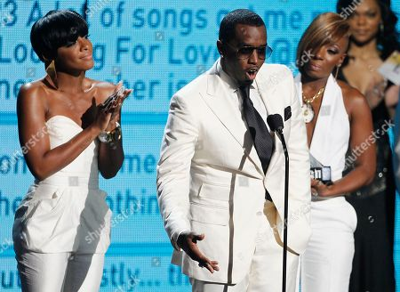 Stock Photo of Diddy Dirty Money, Dawn Richard, Sean Diddy Combs, Kaleena Harper Dawn Richard, left, Sean Diddy Combs, center, and Kalenna Harper of Diddy Dirty Money accept the award for best group at the BET Awards, in Los Angeles