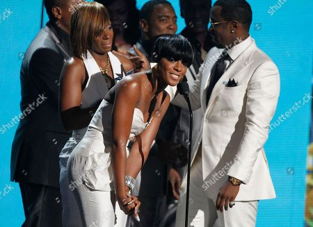 Stock Picture of Diddy Dirty Money, Dawn Richard, Sean Diddy Combs, Kaleena Harper Dawn Richard, center, Sean Diddy Combs, right, and and Kalenna Harper, left, of Diddy Dirty Money accept the award for best group at the BET Awards, in Los Angeles