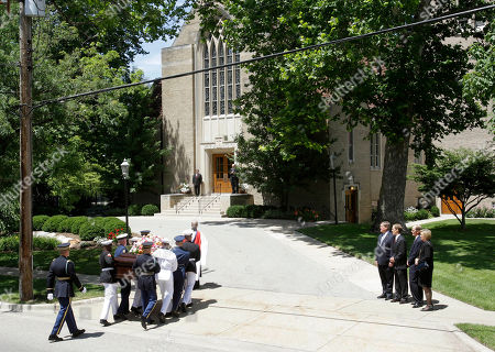 Jack Ford, Mike Ford, Steve Ford and Susan Ford Bales Members of the Ford family, Jack Ford, Mike Ford, Steve Ford and Susan Ford Bales, watch as the casket bearing the body of former first lady Betty Ford is carried by members of the armed forces into Grace Episcopal Church in Grand Rapids, Mich