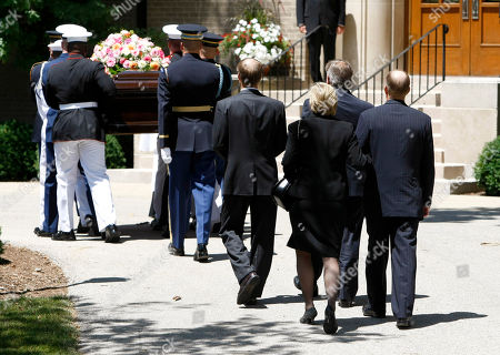 Members of the Ford family, Mike Ford, Jack Ford, Susan Ford Bales and Steve Ford, right, follow as the casket bearing the body of former first lady Betty Ford is carried by members of the armed forces into Grace Episcopal Church in Grand Rapids, Mich