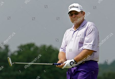 James Mason James Mason reacts after missing an eagle putt on the 18th hole during the final round of the Greater Hickory Classic Champions Tour golf tournament at Rock Barn in Conover, N.C., . Play was suspended after one hole of sudden death due to weather