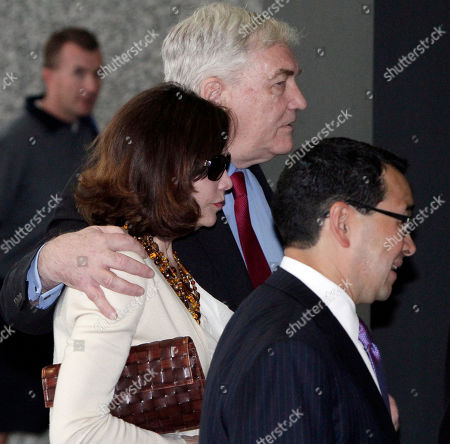 Conrad Black,Barbara Amiel Black, Miguel Estrada Conrad Black and his wife Barbara Amiel Black listen to attorney Miguel Estrada as they leave federal court, in Chicago. Black, a once-powerful media mogul whose newspaper empire spanned several continents, is headed back to prison after a federal judge ruled Friday that he had not served enough time for defrauding investors. U.S. Judge Amy St. Eve sentenced Black to 3½ years in prison, but prosecutors say he will be given credit for about two years he already had served. The resentencing came after an appeals court decision last year