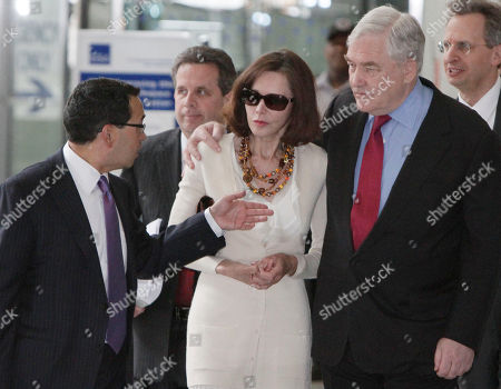 Conrad Black,Barbara Amiel Black, Miguel Estrada Former media mogul Conrad Black and his wife Barbara Amiel Black listen to attorney Miguel Estrada as they leave Federal court, in Chicago, after his resentencing hearing, where a judge decided he had not spent enough time behind bars after a jury convicted Black in 2007, for defrauding investors in Hollinger International Inc. U.S. Judge Amy St. Eve sentenced Black to 31/2 years in prison, but prosecutors say he will be given credit for the about two years he already had served. The resentencing came after an appeals court decision last year