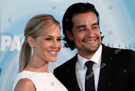 Julie Benz, Rich Orosco Julie Benz, left, and Rich Orosco arrive at the Crystal Lucy Awards on in Beverly Hills, Calif