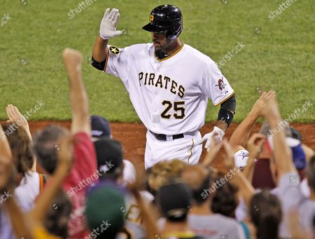 Derrek Lee Pittsburgh Pirates' Derrek Lee (25) returns to the dugout after hitting a two-run home run off Chicago Cubs pitcher Kerry Wood in the eighth inning of a baseball game in Pittsburgh . It was Lee's second home run of the game. The Cubs won 5-3
