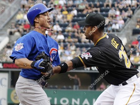 Derrek Lee, Darwin Barney Pittsburgh Pirates first baseman Derrek Lee, right, tags Chicago Cubs' Darwin Barney at home plate to end a first-inning rundown during a baseball game in Pittsburgh on