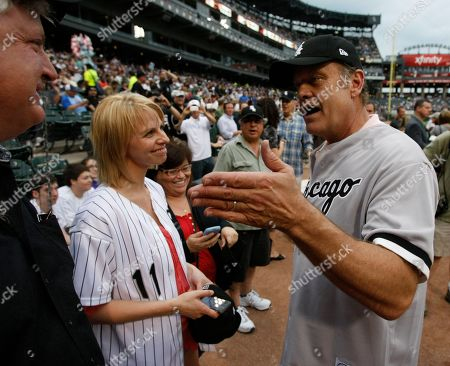 Stock Photo of Kelsey Grammer Actor Kelsey Grammer, right talks with is wife Kayte and close friend Carl Degersdorff after he threw out a ceremonial first pitch before an interleague baseball game between the Chicago White Sox and the Chicago Cubs in Chicago