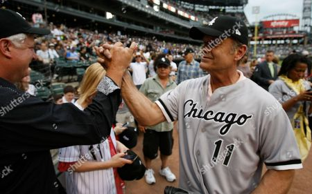 Stock Picture of Kelsey Grammer Actor Kelsey Grammer, right, high fives talks close friend Carl Degersdorff after he threw out a ceremonial first pitch before an interleague baseball game between the Chicago White Sox and the Chicago Cubs in Chicago