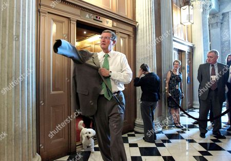 """Kent Conrad Senate Budget Committee Chairman Kent Conrad, R-N.D., followed by his pet dog """"Dakota,"""" heads to the Senate floor for the final vote on the debt and deficit-reduction bill at the Capitol, in Washington"""