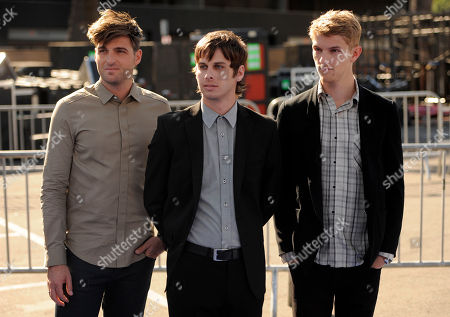 Cubbie Fink, Mark Foster, Mark Pontius From left, Cubbie Fink, Mark Foster and Mark Pontius, of music group Foster the People, arrive at the Do Something Awards, in Los Angeles