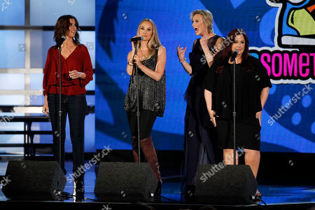 Wendy Wilson, Chynna Phillips, Carnie Wilson, Jane Lynch Wendy Wilson, far left, Chynna Phillips, second from left, and Carnie Wilson, far right, of the band Wilson Phillips perform onstage as Jane Lynch looks on at the Do Something Awards, in Los Angeles