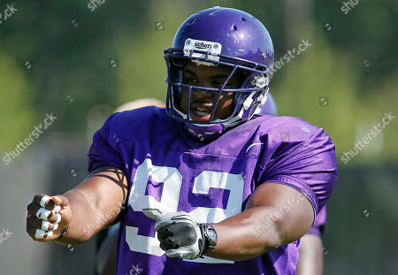 Michael Brooks In this photo made, East Carolina defensive tackle Michael Brooks participates in training drills during an NCAA colllege football practice in Greenville, N.C