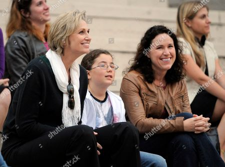 """Stock Photo of Jane Lynch, Lara Embry Jane Lynch, left, a cast member in the television series """"Glee,"""" watches scenes from the show alongside her wife Dr. Lara Embry, right, and Embry's daughter Haden during the """"Glee Sing-A-Long"""" event at Santa Monica High School in Santa Monica, Calif., . Musical numbers from the second season of the television show were screened for fans and Academy of Television Arts & Sciences members"""