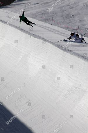 Kevin Holland, Xavier Bertoni Kevin Holland, right, and 2009 Winter X Games Champion Xavier Bertoni practice tricks on the superpipe as they prepare for the Winter X Games at Park City Mountain Resort in Park City, Utah. Though they just arrived at this Utah mountain town, they know this is the pipe where Canadian freestyle skier Sarah Burke suffered a traumatic brain injury days earlier. And it is the same pipe where champion snowboarder Kevin Pearce was seriously injured two years ago, leaving him in a coma for weeks and hospitalized for months
