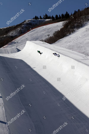 Members of the French National team practice for the Winter X Games as a shadow is cast into the 22-foot superpipe at Park City Mountain Resort in Park City, Utah. Though they just arrived at this Utah mountain town, they know this is the pipe where Canadian freestyle skier Sarah Burke, in critical condition at a nearby hospital, was injured just days ago. And it is the same pipe where champion snowboarder Kevin Pearce suffered a traumatic brain injury two years ago