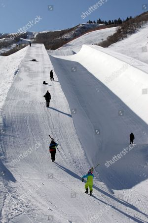Stock Photo of Members of the French National team practice for the Winter X Games as a shadow is cast into the 22-foot superpipe at Park City Mountain Resort in Park City, Utah. Though they just arrived at this Utah mountain town, they know this is the pipe where Canadian freestyle skier Sarah Burke, in critical condition at a nearby hospital, was injured just days ago. And it is the same pipe where champion snowboarder Kevin Pearce suffered a traumatic brain injury two years ago