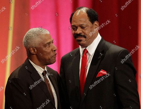 Stock Photo of Dennis Rodman Artis Gilmore, right, is joined by his presenter Julius Erving during a Basketball Hall of Fame enshrinement ceremony in Springfield, Mass., on Friday night