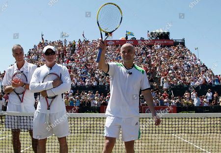 Andre Agassi, Todd Martin, Brad Gilbert Tennis great Andre Agassi waves to the crowd after an exhibition match, prior to the Hall of Fame Tennis Championship final in Newport, R.I. Agassi was inducted to the International Tennis Hall of Fame on Saturday. At far left is former player Todd Martin, and Agassi's former coach Brad Gilbert