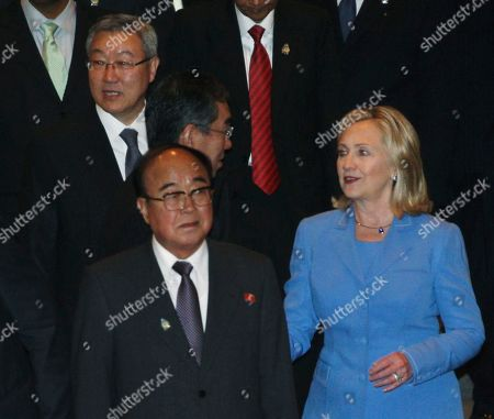 Pak Ui Chun, Kim Sung-hwan, Hillary Rodham Clinton, Takeaki Matsumoto South Korean Foreign Minister Kim Sung-hwan, top left, walks by his North Korean counterpart Pak Ui Chun, bottom center, as U.S. Secretary of State Hillary Rodham Clinton talks with Japanese Foreign Minister Takeaki Matsumoto, center, prior to the start of ARF Retreat Session in Nusa Dua, Bali, Indonesia, . Clinton is telling North Korea that it must do more to improve ties with the South before the U.S. and other countries will return to nuclear disarmament talks