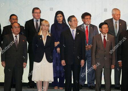 Pak Ui Chun, Elzbieta Bienkowska, Takeaki Matsumoto, Thongloun Sisoulith, Gombojav Zandanshatar, Wunna Maung Lwin, Murray McCully, Hina Rabbani Khar, Ano Pala, Albert del Rosario ASEAN Regional Forum ministers, front row from left, North Korea's Pak Ui Chun, European Union's representative Elzbieta Bienkowska, Japan's Takeaki Matsumoto, Laos' Thongloun Sisoulith and top row from left, Mongolia's Gombojav Zandanshatar, Myanmar's Wunna Maung Lwin, New Zealand's Murray McCully, Pakistan's Hina Rabbani Khar, Papua New Guinea's Ano Pala, Philippine Albert del Rosario prepare for a group photo prior to the ASEAN Regional Forum Retreat Session in Nusa Dua, Bali, Indonesia
