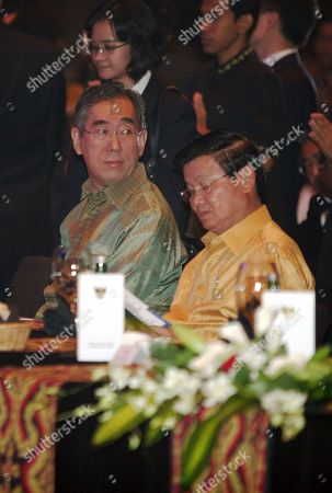 Takeaki Matsumoto Thongloun Sisoulith Japan's Foreign Minister Takeaki Matsumoto, left, and his Lao counterpart Thongloun Sisoulith, right, attend a gala dinner at the 44th ASEAN foreign ministerial meeting in Nusa Dua, Bali, Indonesia