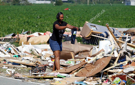 Laura Spencer Laura Spencer tires to savage her grandson's clothes after her daughter's home was hit by Hurricane Irene Saturday in Columbia, N.C. The storm killed at least 14 people and left 4 million homes and businesses without power. It unloaded more than a foot of water on North Carolina and spun off tornadoes in Virginia, Maryland and Delaware