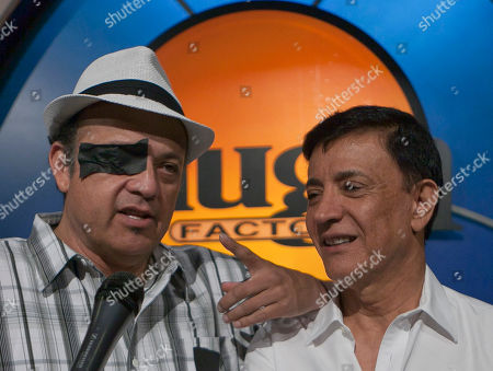 """Paul Rodriguez, Jaime Masada Comedian Paul Rodriguez, left, wears a """"black eye"""" patch, to express his support for Jerry Lewis to be reinstated as host of the annual MDA Telethon, as he joins Laugh Factory owner Jaime Masada, right, at the Laugh Factory in Los Angeles, in Los Angeles. Lewis and the Muscular Dystrophy Association aren't saying why they're fully parting ways after 45 years and raising more than $ 1 billion for the nonprofit through its annual telethon"""