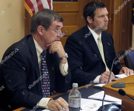 Kansas Secretary of Administration Dennis Taylor, left, and Secretary of State Kris Kobach, right, listen to a presentation on new regulations for abortion clinics, at the Statehouse in Topeka, Kan. Taylor and Kobach are members of the State Rules and Regulations Board, which is allowing the regulations to take effect on Friday, July 1, 2011. Planned Parenthood disclosed Thursday that its Kansas clinic had been denied a state license to continue performing abortions as the group filed its own lawsuit to block new state rules that will make Kansas the first state in the nation without an abortion provider