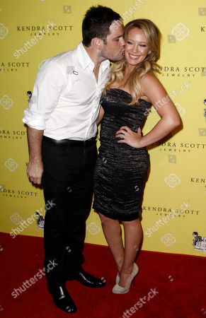 Hillary Duff, Mike Comrie Actress Hillary Duff, right, and Mike Comrie arrive at the grand opening party for Kendra Scott Jewelry's Beverly Hills Store benefiting Blessings in a Backpack in West Hollywood, Calif