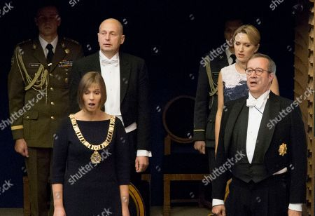 Stock Photo of Estonia's president-elect Kersti Kaljulaid, foreground left, and former Estonian President Toomas Hendrik Ilves, foreground right, sing the national anthem during her inauguration in the parliament in Tallinn, Estonia, . Estonia's president-elect Kersti Kaljulaid has been sworn in as the Baltic country's first female head of state and its fourth president since independence in 1991